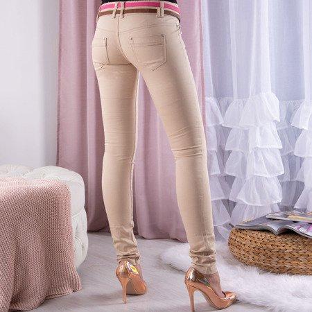Beżowe spodnie z niskim stanem - Spodnie