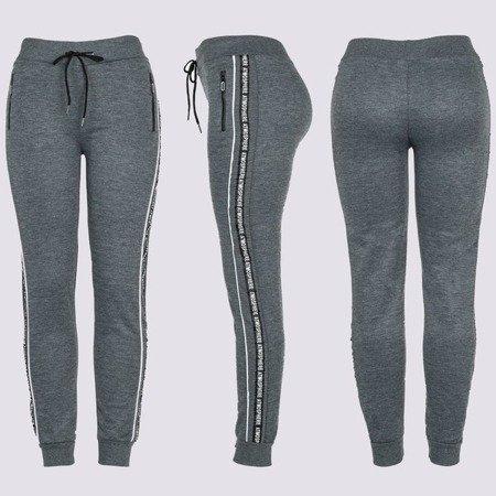 Ciemnoszare damskie spodnie dresowe z napisami - Spodnie