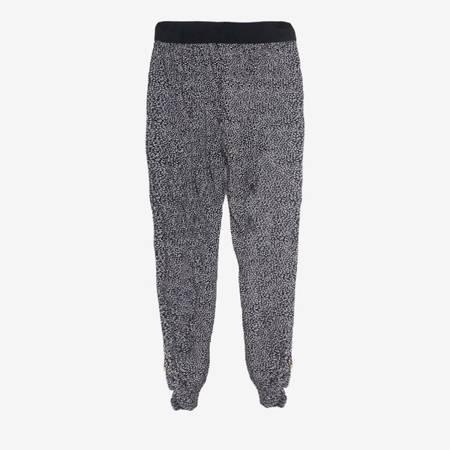 Czarne wzorzyste spodnie alladynki - Odzież