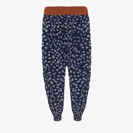 Granatowe spodnie alladynki we wzorki - Odzież