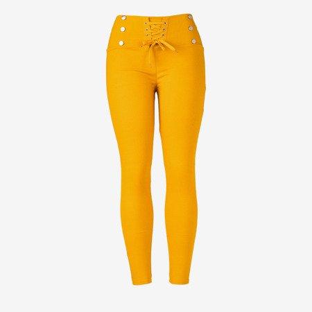 Musztardowe damskie spodnie typu tregginsy z wiązaniem - Odzież