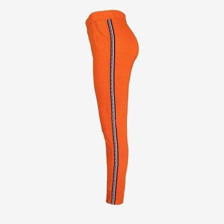 Pomarańczowe damskie spodnie dresowe z lampasami - Spodnie