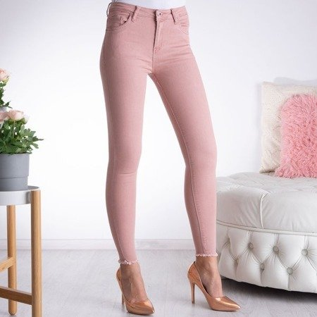 Różowe spodnie typu rurki z wysokim stanem - Spodnie